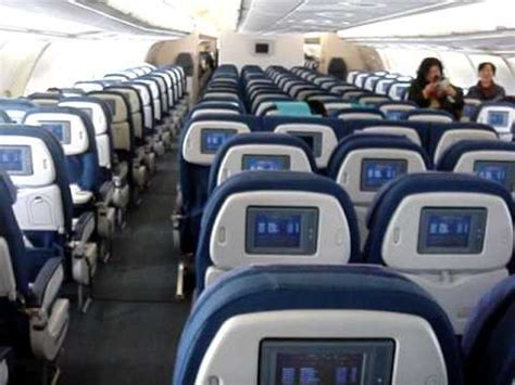 Cathay Pacific Airways A330-300 Economy class cabin - YouTube
