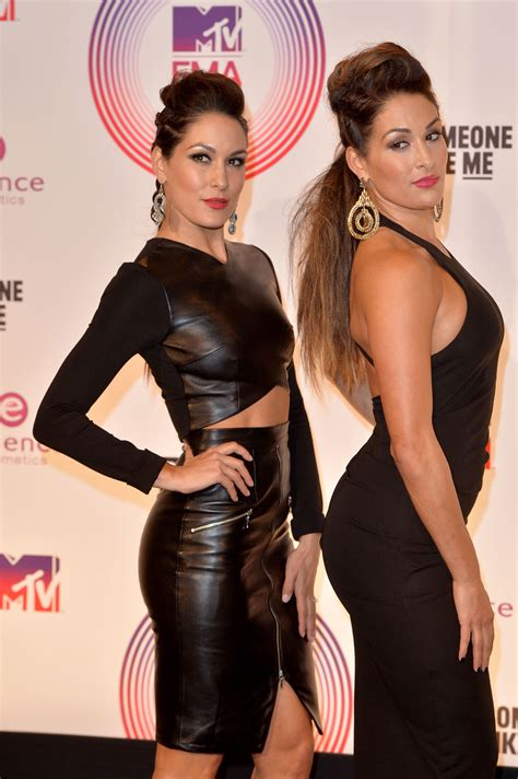 The Bella Twins attend 2014 MTV EMA - Leather Celebrities